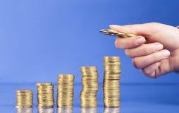 Voert van gouden muntstukken op Stock Foto