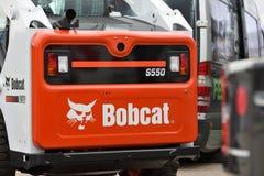 Voertuig en embleem van het Bobcat het het op zwaar werk berekende materiaal Stock Foto