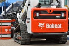Voertuig en embleem van het Bobcat het het op zwaar werk berekende materiaal Royalty-vrije Stock Foto