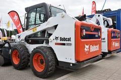 Voertuig en embleem van het Bobcat het het op zwaar werk berekende materiaal Stock Afbeeldingen