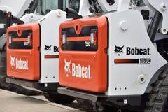 Voertuig en embleem van het Bobcat het het op zwaar werk berekende materiaal Royalty-vrije Stock Foto's