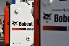 Voertuig en embleem van het Bobcat het het op zwaar werk berekende materiaal stock afbeelding