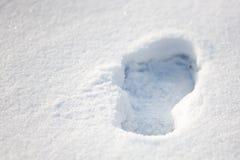 Voetafdruk in de sneeuw Stock Afbeeldingen