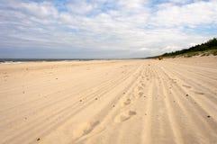 Voetafdrukken in het zand Stock Afbeeldingen