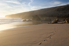 Voetafdrukken op het strand stock fotografie