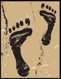 voetafdrukken op zand grunge Royalty-vrije Stock Afbeeldingen