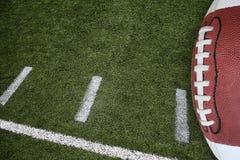 Voetbal en gebied Stock Foto's