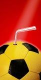 Voetbal en stro stock afbeeldingen