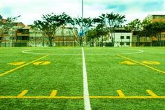 Voetbal en voetbalgebied stock afbeelding