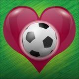 Voetbal in het hart van Stock Fotografie