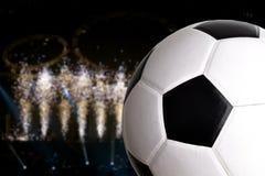 Voetbal met mooie verlichting op achtergrond royalty-vrije stock afbeeldingen