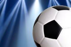 Voetbal met mooie verlichting op achtergrond stock afbeelding