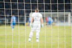 Voetbal netto tijdens een voetbal mach Nadruk op het net stock foto