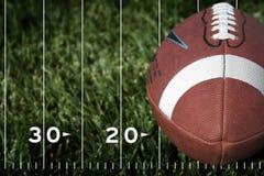 Voetbal op een gebied Stock Afbeelding