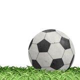 Voetbal op gebied gerecycleerde document ambacht Royalty-vrije Stock Afbeelding