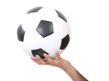 Voetbal op hand Stock Afbeeldingen