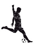 Voetbal (voetbal) speler met bal Stock Fotografie
