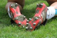 Voetbal of voetballaarzen Stock Foto's
