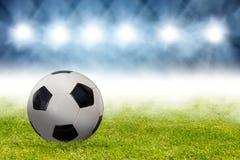 Voetbalbal in arena Stock Foto