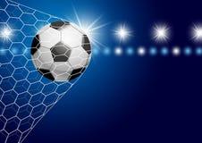 Voetbalbal in doel met schijnwerper royalty-vrije illustratie