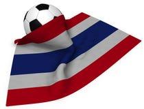 Voetbalbal en vlag van Thailand Stock Fotografie