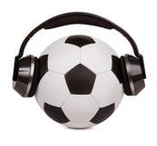 Voetbalbal met hoofdtelefoons Royalty-vrije Stock Foto