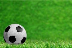 Voetbalbal op Gebied met Exemplaarruimte Stock Afbeeldingen