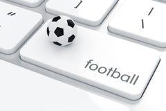 Voetbalbal op het computertoetsenbord Stock Fotografie
