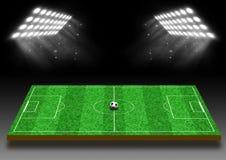 Voetbalgebied met een gazon onder lichten Stock Fotografie