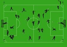Voetbalgebied met spelers en scheidsrechters Stock Afbeeldingen