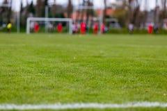 Voetbalhoogte met vage spelers royalty-vrije stock afbeelding
