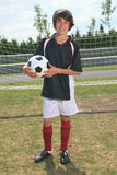 Voetbaljong geitje stock foto