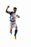 Voetballer in actie stock afbeelding