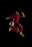 Voetballer in actie stock foto
