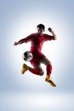Voetballer in actie stock foto's