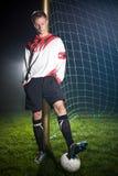 Voetballer in dark Royalty-vrije Stock Afbeeldingen