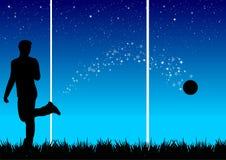 Voetballer in de nacht Royalty-vrije Stock Foto's