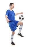 Voetballer met een bal stock afbeelding
