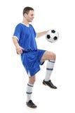 Voetballer met een bal stock fotografie