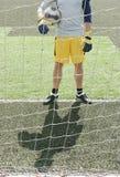 Voetballer met poort Stock Afbeelding