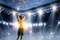 Voetballer op stadion in actie Gemengde media royalty-vrije stock foto's