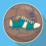 Voetbalpictogram Voetbalbal met blauwe laars op bruine achtergrond Sporteninventaris Stock Afbeeldingen