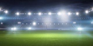 Voetbalstadion in lichten stock afbeeldingen