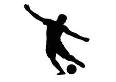 Voetbalster die bal schieten stock foto
