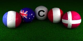 Voetbalwereldbeker 2018 ballen met de vlag van Groep C Frankrijk Aust Stock Afbeeldingen