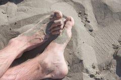 Voeten op zand Stock Foto's