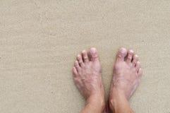 Voeten op zand Stock Afbeelding