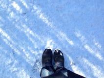Voeten over sneeuw Stock Fotografie