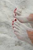 Voeten in zand Stock Foto's