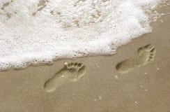 Voetstappen in het zand Stock Afbeeldingen